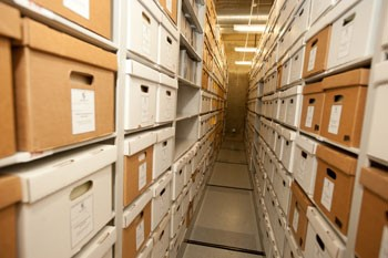 Records shelved in the archives storage facility in Aquinas Hall