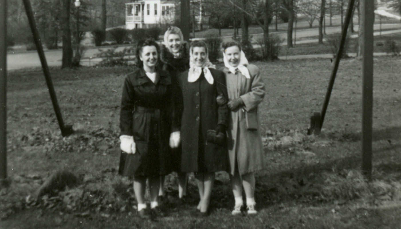 Historical photo of four women on the Catholic University campus