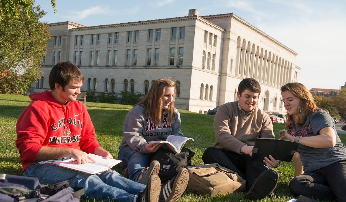 Students studying outside Mullen Library